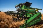 John Deere X Series harvesting wheat