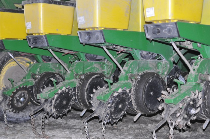 WHEELS OF FORTUNE. This year, Bland experimented with a variety of different closing wheels on his 24-row John Deere planter to determine the best fit for planting in wetter clay soils. Some performed better than others closing the strip, but Bland says he's still not sure which is the right one for his fields.